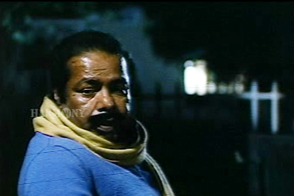 Thilakan the step-dad in Namukku Parkkan Munthiri Thoppukal (1986)
